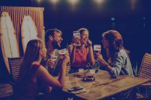 People enjoying beer together.